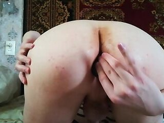 Young gay entertains himself with toys and butt plugs